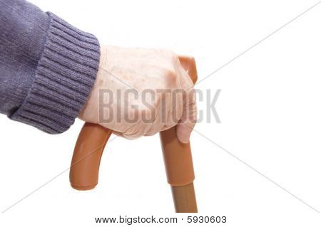 Old Woman Hand Leans On Walking Stick
