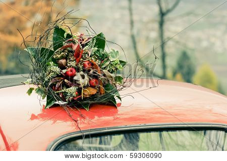 Autumnal Bouquet On The Top Of Retro Car
