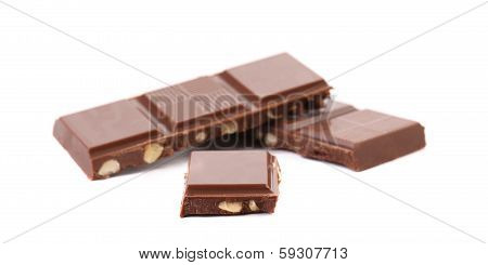 Morsels of milk chocolate with nuts