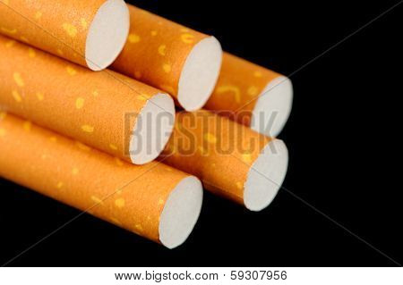 Cigarettes With Yellow Filters On Black Background