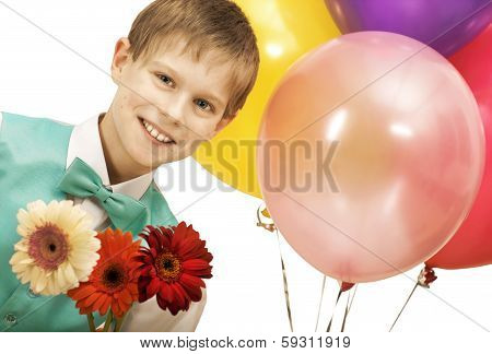 Smiling boy with balloons