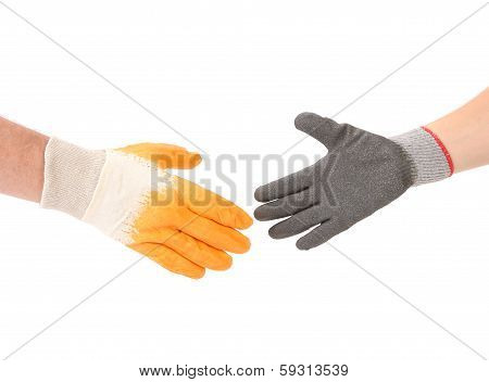 Two hands gloves meet in hand shake.