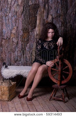 Sad Young Woman With A Spinning Wheel
