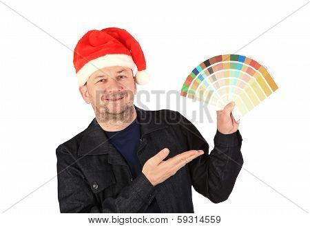 Man in santa's hat with color samples.
