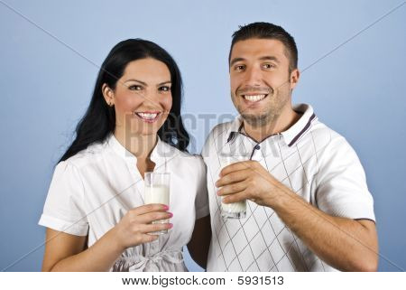 Happy Couple In White Holding Glasses With Milk