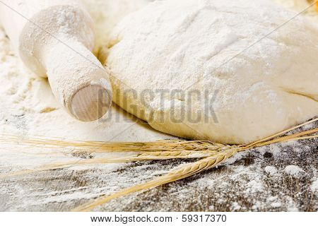 White bread drought and flour on kitchen table