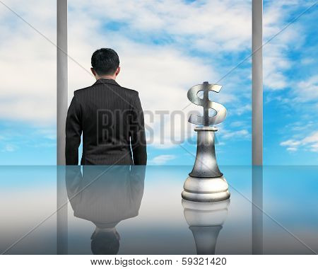 Businessman Facing Blue Sky With Usd Symbol Piece On Table