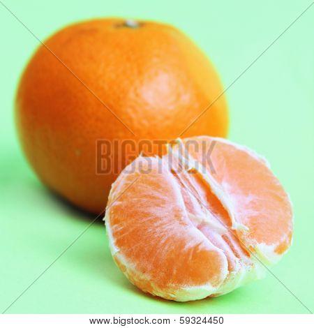 Peeled Orange On The Green Background