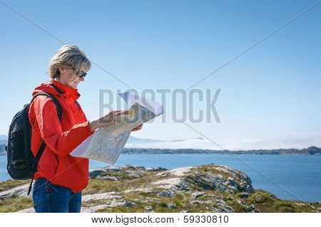 Woman tourist reading the map