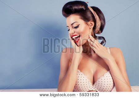 Beauty Smiling Pinup Girl On Blue Wall