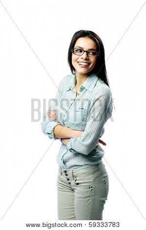 Young smiling woman standing and looking away on white background