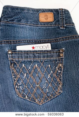 DAYTON, OHIO-FEBRUARY 2, 2014:Bandolino designer jeans pocket with Macys credit card. Bandolino is fashions by designer, Enzo Anioglini; Macys is USAs largest retail department store in retail sales.