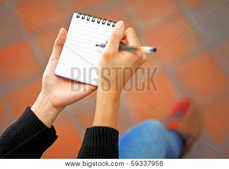 Woman hand jot note