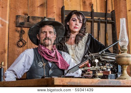 Gruff Cowboy Poses With Saloon Girl