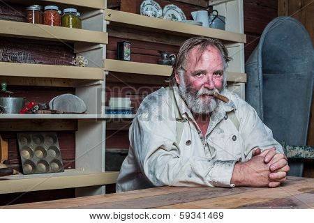 Smoking Western Man At Table