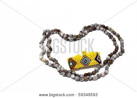 Two Isolated Hand Made Bead Necklaces And Colorful Bracelet