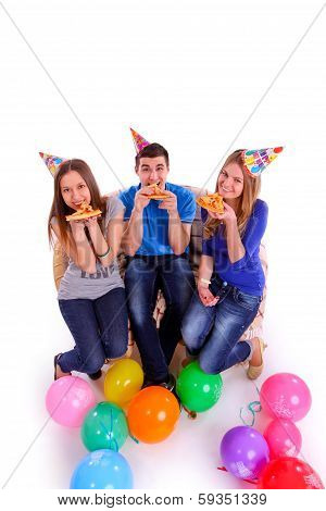 Three Friends With Hats And Balloons Eating Pizza