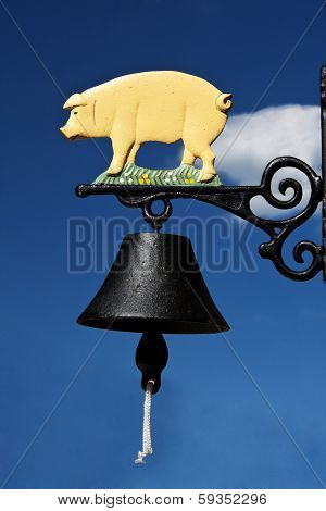Bell With Piglet On Blue Sky