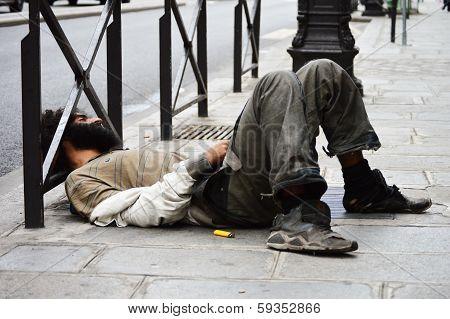 Homeless Man Sleeping On The Street In Paris
