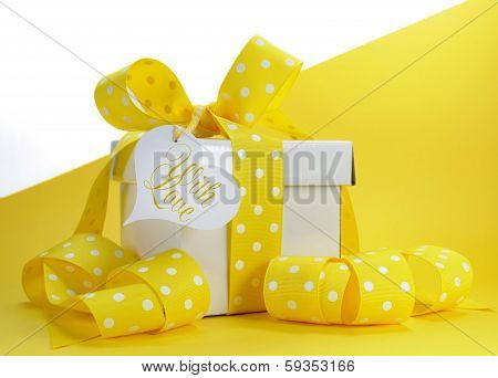 Yellow Theme Gift Box With Yellow Polka Dot Ribbon And White Copy Space For Easter, Birthday, Weddin