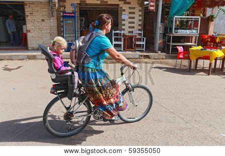 DAHAB, EGYPT - JANUARY 28, 2011: Local woman drives her daughter on a bicycle. The Girls Revolution is now launching a new campaign