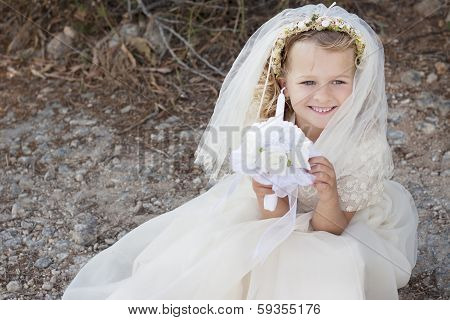First Holy Communion Girl With Dress, Veil And Candle