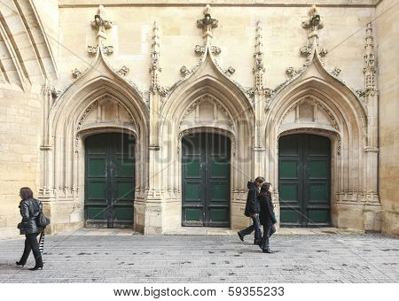 BORDEAUX, FRANCE - DECEMBER 22, 2011: Tourists near Great Bell of Bordeaux (Grosse cloche). Until the Liberation, at the end of the WW II, the clock announced all of the important events.
