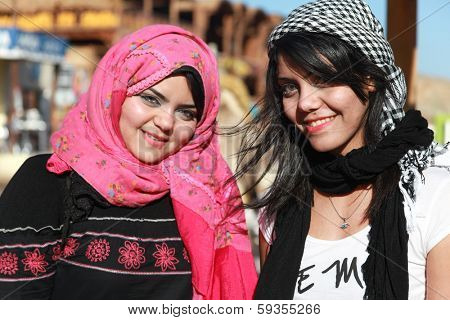 DAHAB, EGYPT - JANUARY 30, 2011: Portrait of modern young Egyptian girls woman wearing hijab, traditional head cover or wrap worn by Muslim women.