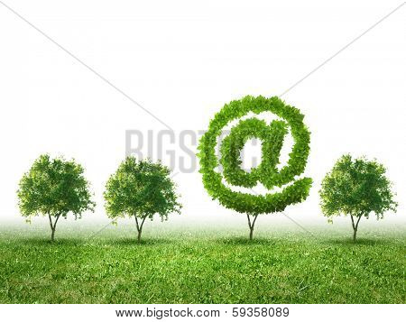 Conceptual image of green plant shaped like email sign