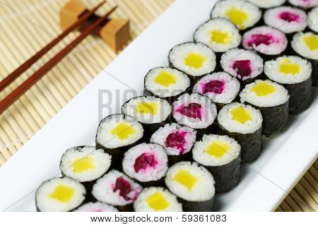 Fresh Hand Rolled Pickled Sushi In Large White Plate