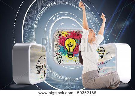 Businesswoman sitting cross legged cheering against black background with glowing circle