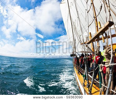 HUSAVIK, ICELAND - JUNE 19, 2013: Whale Watching on a Schooners, a traditional icelandic sailboat.
