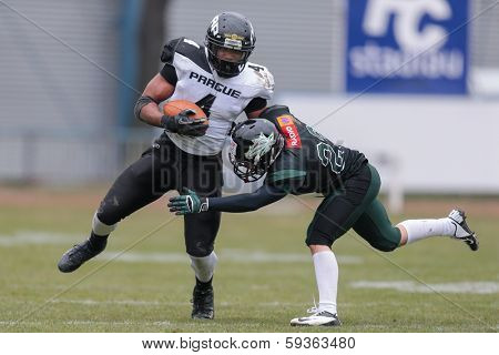 VIENNA,  AUSTRIA - APRIL 6 DB Mario Vetr (#23 Dragons) tackles DB Andre Whyte (#4 Panthers) during the AFL football game on April 6, 2013 in Vienna, Austria.