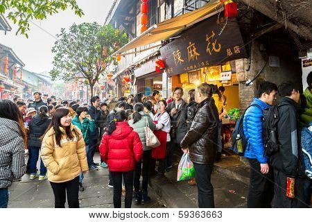 CHONGQING, CHINA - JAN 17: Unidentified tourists are shopping at Ciqikou Ancient Town on January  17, 2014 , Chongqing, China.