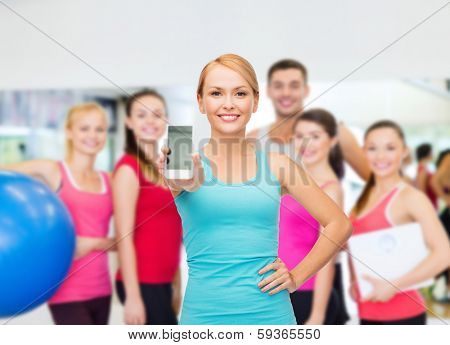 sport, excercise, technology, internet and healthcare - sporty woman with blank smartphone screen