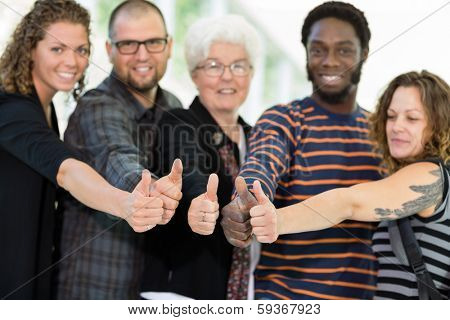 College students giving thumbs up with professor