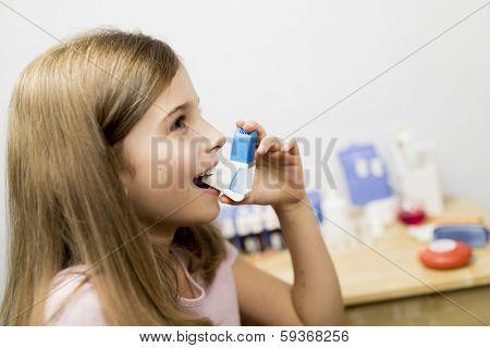 Allergy - cute girl using inhaler