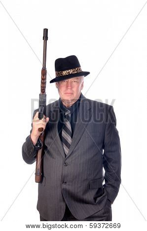 Gangster or FBI agent with sub-machine gun isolated on white