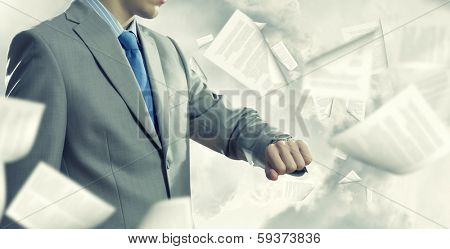 Close up of businessman looking at watch