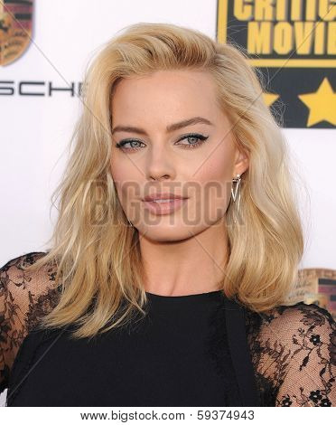 LOS ANGELES - JAN 16:  Margot Robbie arrives to the Critics' Choice Movie Awards 2014  on January 16, 2014 in Santa Monica, CA