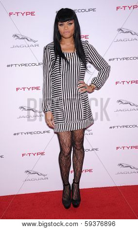 LOS ANGELES - NOV 19:  Andra Day arrives to the Jaguar F-TYPE Global Reveal Event  on November 19, 2013 in Playa Vista, CA