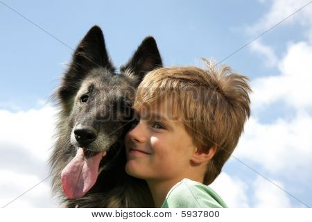 smiling cute boy with Belgian shepherd