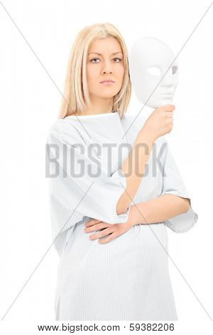 Blond female in hospital gown holding a theater mask and looking at camera isolated on white background