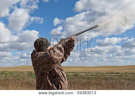 Hunter firing a gun