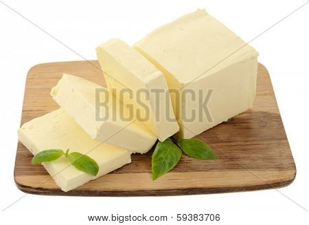 Tasty butter on wooden cutting board isolated on white