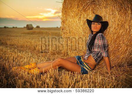 Beautiful Cowgirl In Hay
