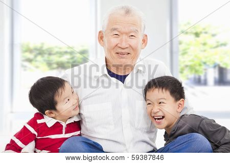 Happy Grandfather And Grandchildren Playing