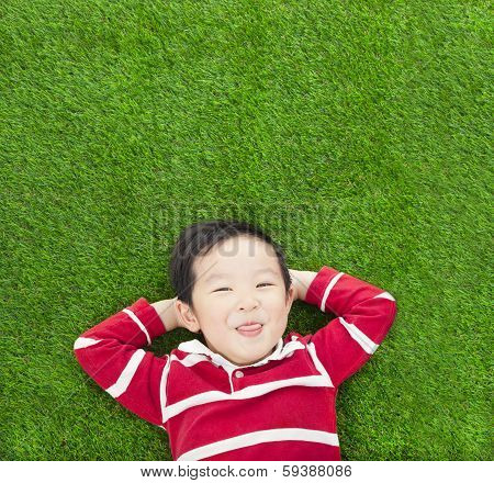 A Funny Kid Lying And Holding His Head