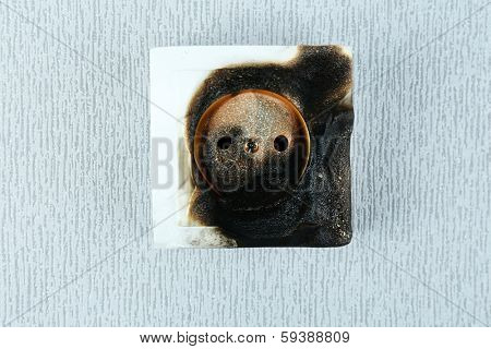 Burned plug socket close up
