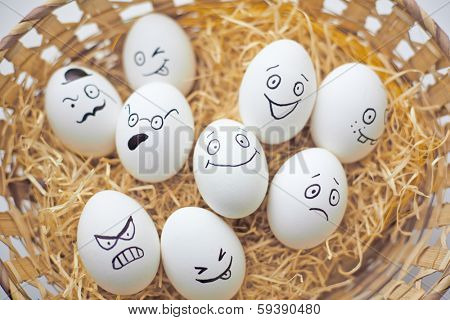 Easter eggs with different facial expressions in basket